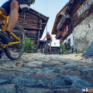 Mountainbiker at the village of Albinen
