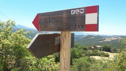 One of the typical red and white signposts.