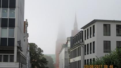 Dom und Herz-Jesu-Kirche  liegen noch im Nebel