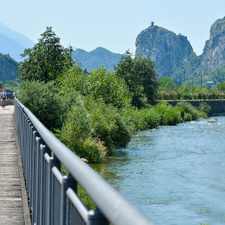 The cycle path along river Sarca (The Castle of Arco in the background)