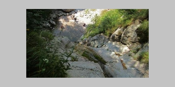View from the top of the Krampež Waterfall - there is not much water running during the summer drought