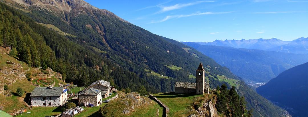 Alpe Romerio und Kirche San Romerio.