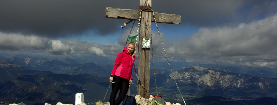 A wooden cross at the top of Mangart.