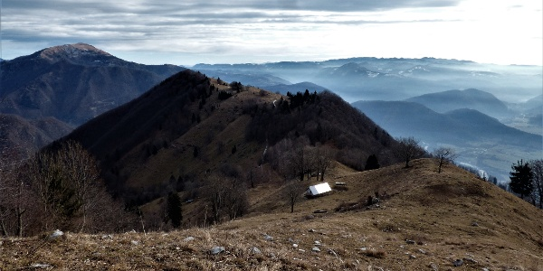 After crossing the fence along the trail from Mt. Grmuč you notice the slope of Mt. Vodil vrh
