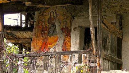 Freske an einer Gebäudemauer.