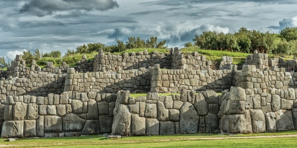 Arrive at the mighty walled complex of Sacsayhuaman and nearby ancient ruins