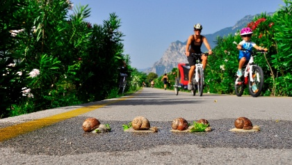 Riding with kids on the cycle path along river Sarca
