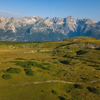 The meadows around hut Bait del Germano and the Brenta Dolomites