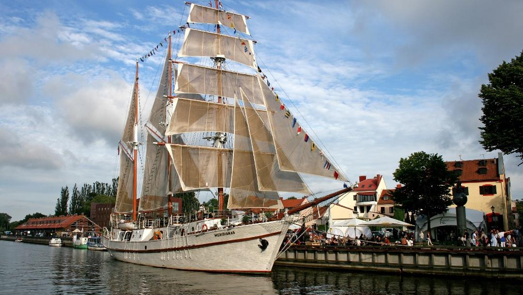 Sailing ship Meridianas under full sails at her mooring in Klaipeda