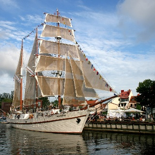Sailing ship Meridianas under full sails at her mooring in Klaipeda