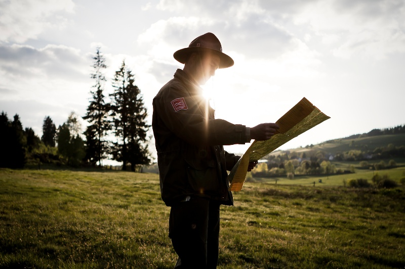 Ranger Matthias Speck looks at his hiking map