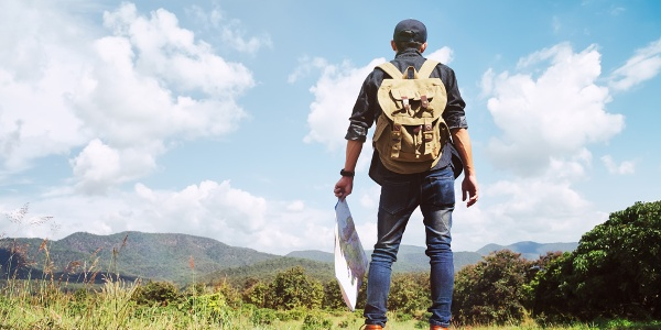 Young Man Traveler with backpack relaxing outdoor.