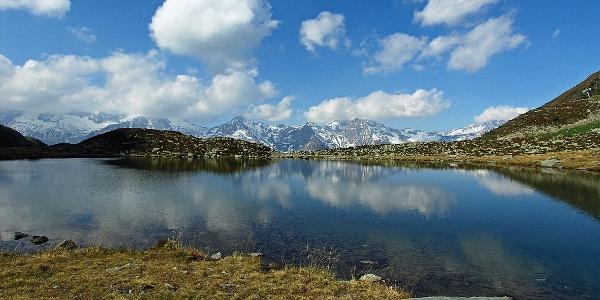The idyllic lago Klaussee lake over Cadiepietra in Valle Aurina valley.