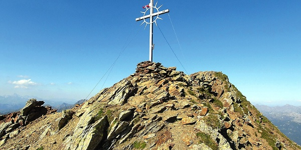 The summit cross on the mountain Cervina.