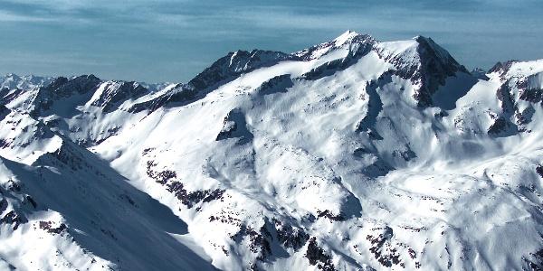 The Punta Bianca peak, powerfull mountain high above the lake Neves dam.