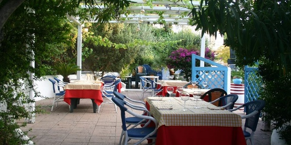 Enjoy the delicious food on the spacious terrace, surrounded by the scent of Mediterranean vegetation.