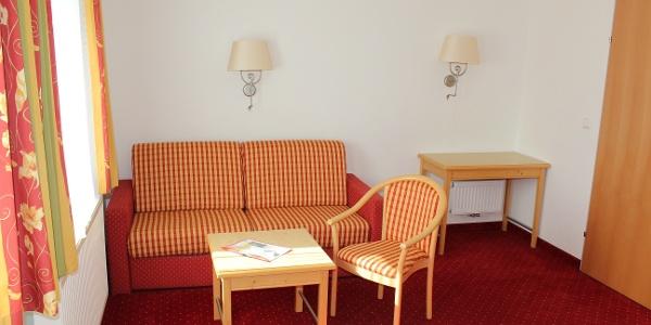 Sitzgruppe im Doppelzimmer